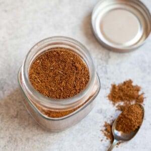 Roasted cumin powder in a glass jar