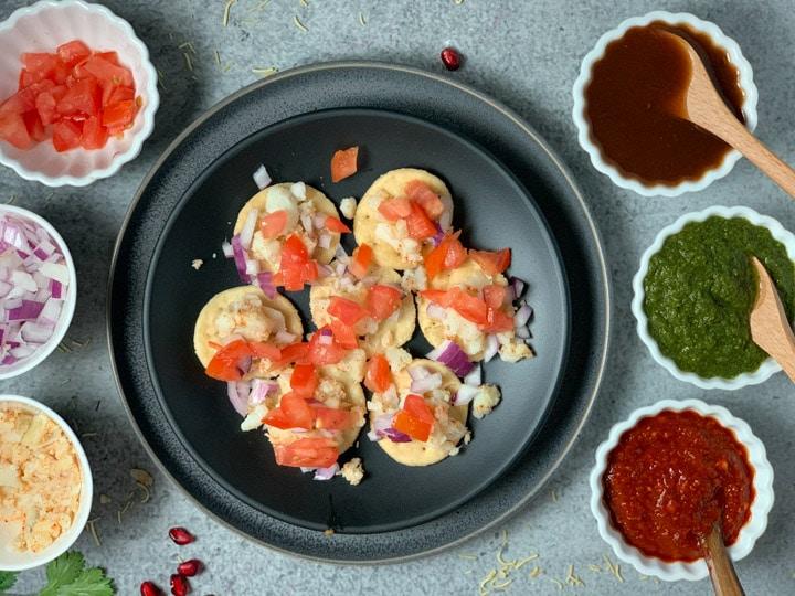 Potato, onion and tomato topped on puri