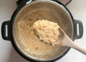 Sakkarai Pongal cooked closedup in a ladle
