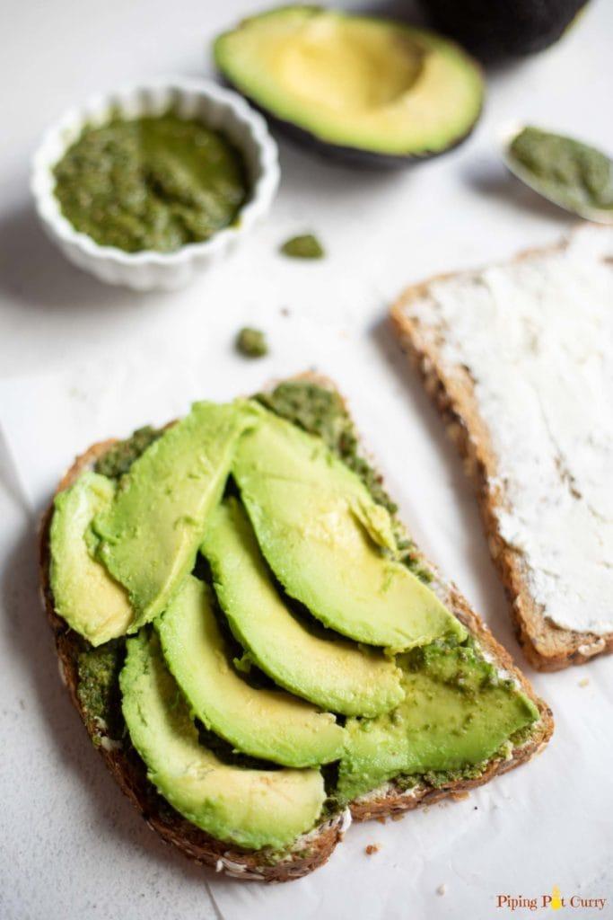 Sliced avocado on bread to make sandwich