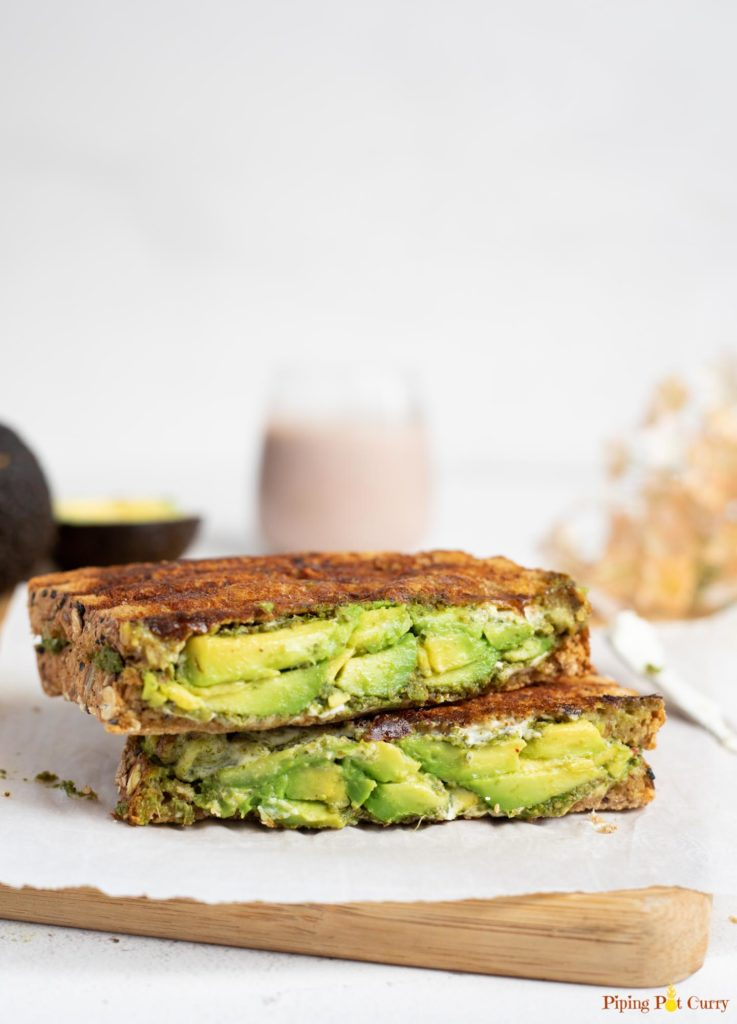 Toasted avocado sandwich on a cutting board