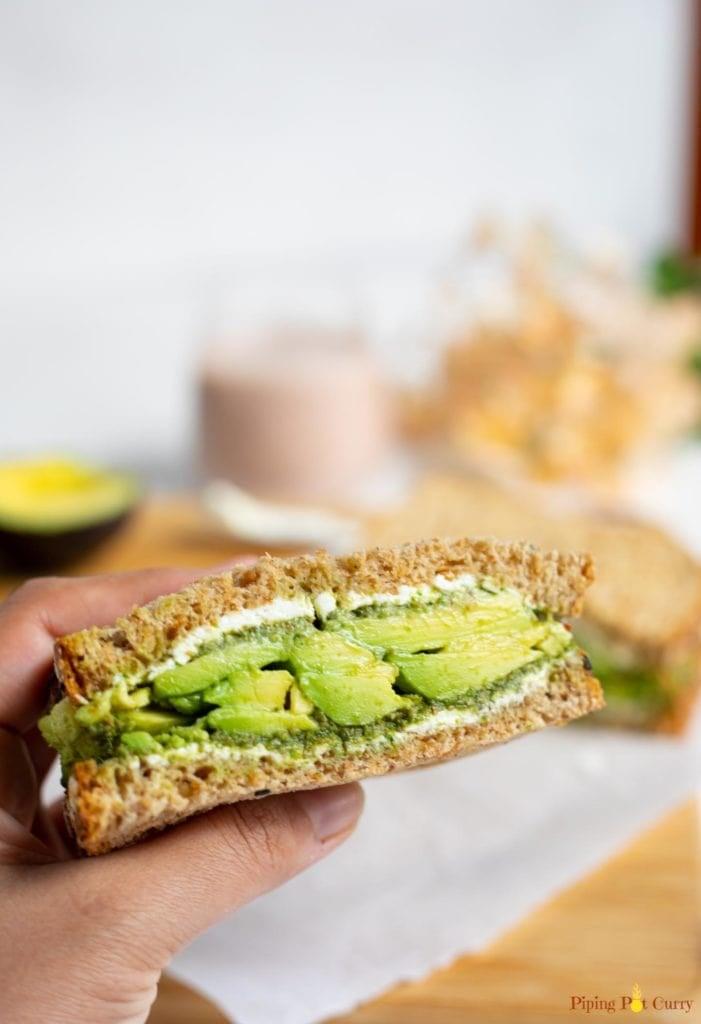 Avocado sandwich in hand