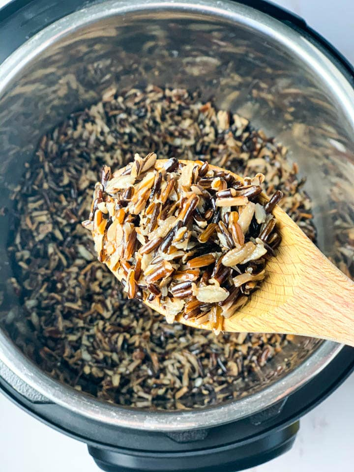Wild rice in a ladle over the instant pot