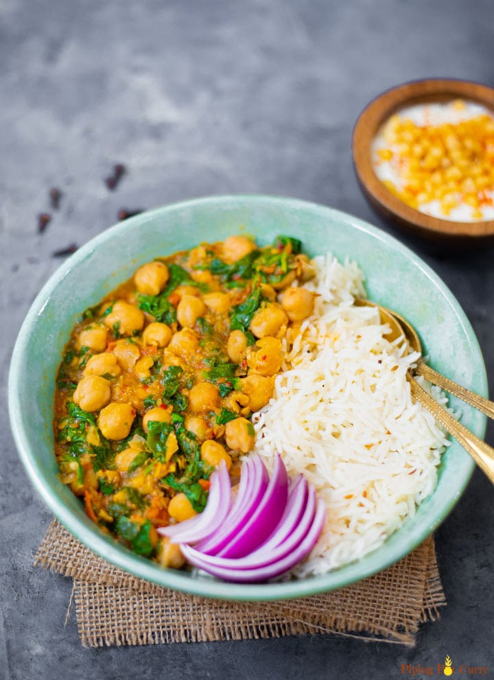 Chickpea and spinach curry with white basmati rice and onions