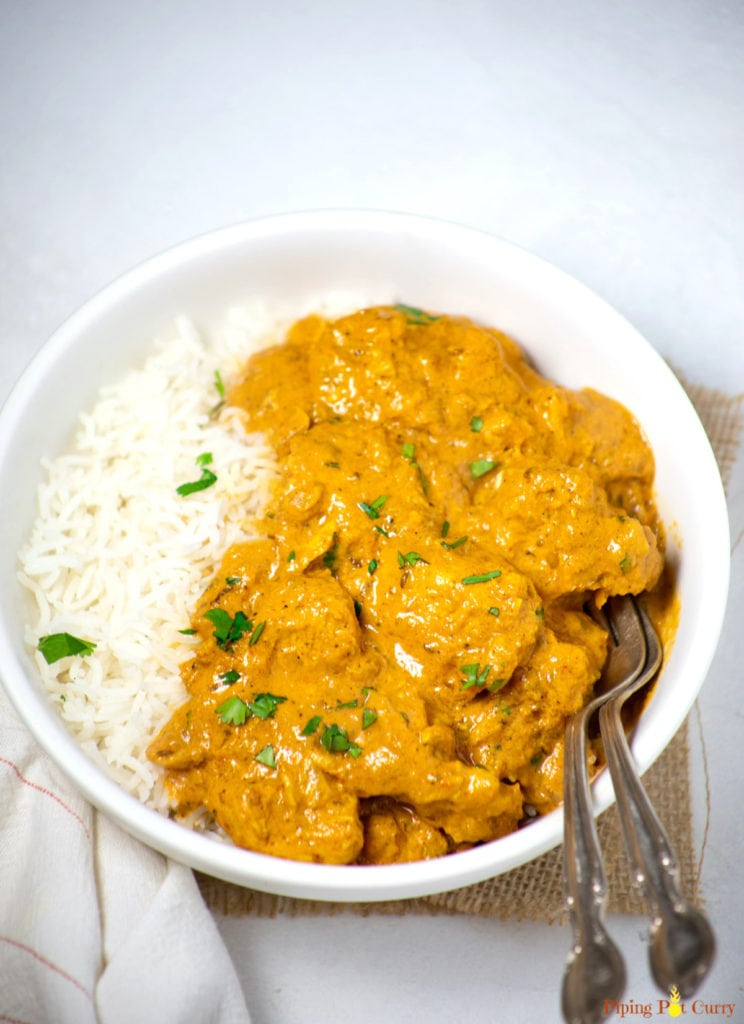 Easy Coconut Curry chicken in a white bowl