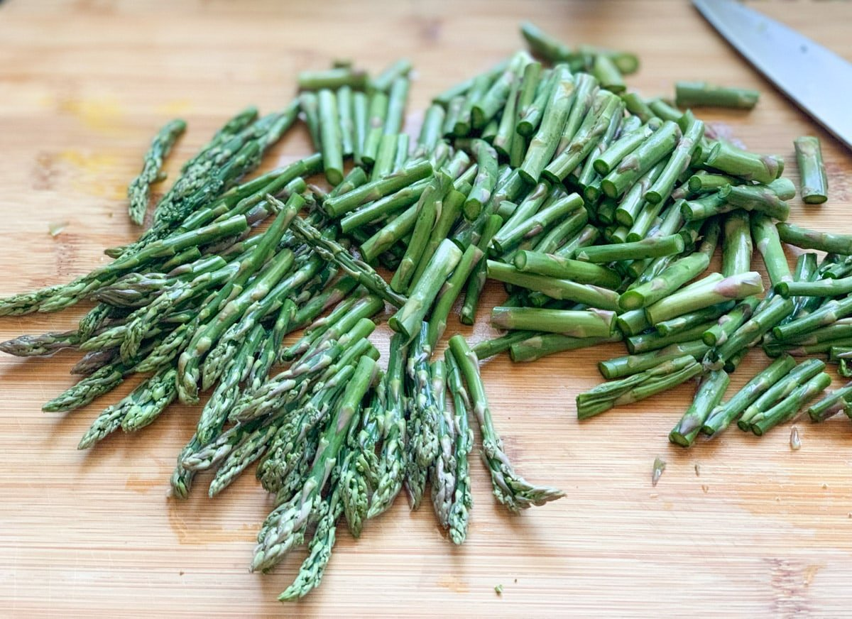 Asparagus chopped on a cutting board
