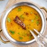 Gujarati Dal in a hand bowl garnished with cilantro