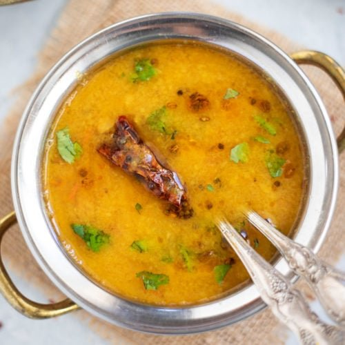 Gujarati Dal in a hand bowl garnished with cilantro