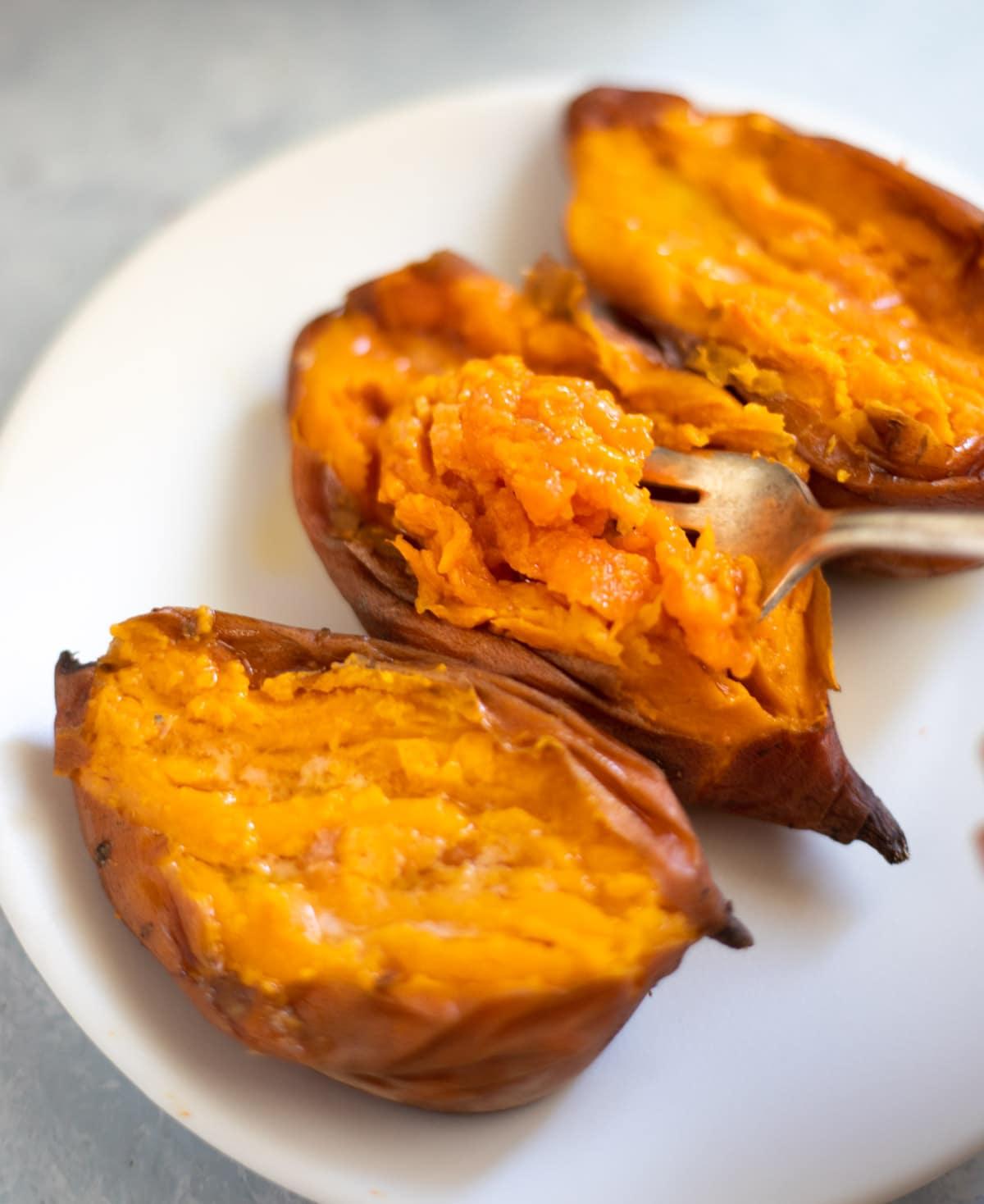 Tender creamy sweet potato flesh in a fork