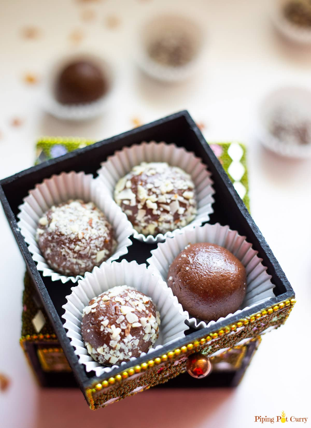 Four Chocolate Ladoo balls In a small decorated box
