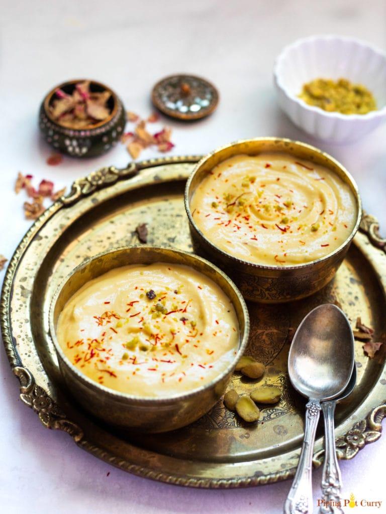 mango shrikhand served in two bowls garnished with saffron