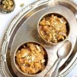 Moong Dal Halwa sweet served in 2 bowls topped with chopped nuts