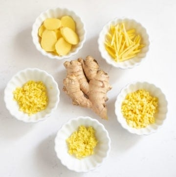 fresh Ginger root cut in 5 ways in small bowls - slice, chop, mince, julienne, grate
