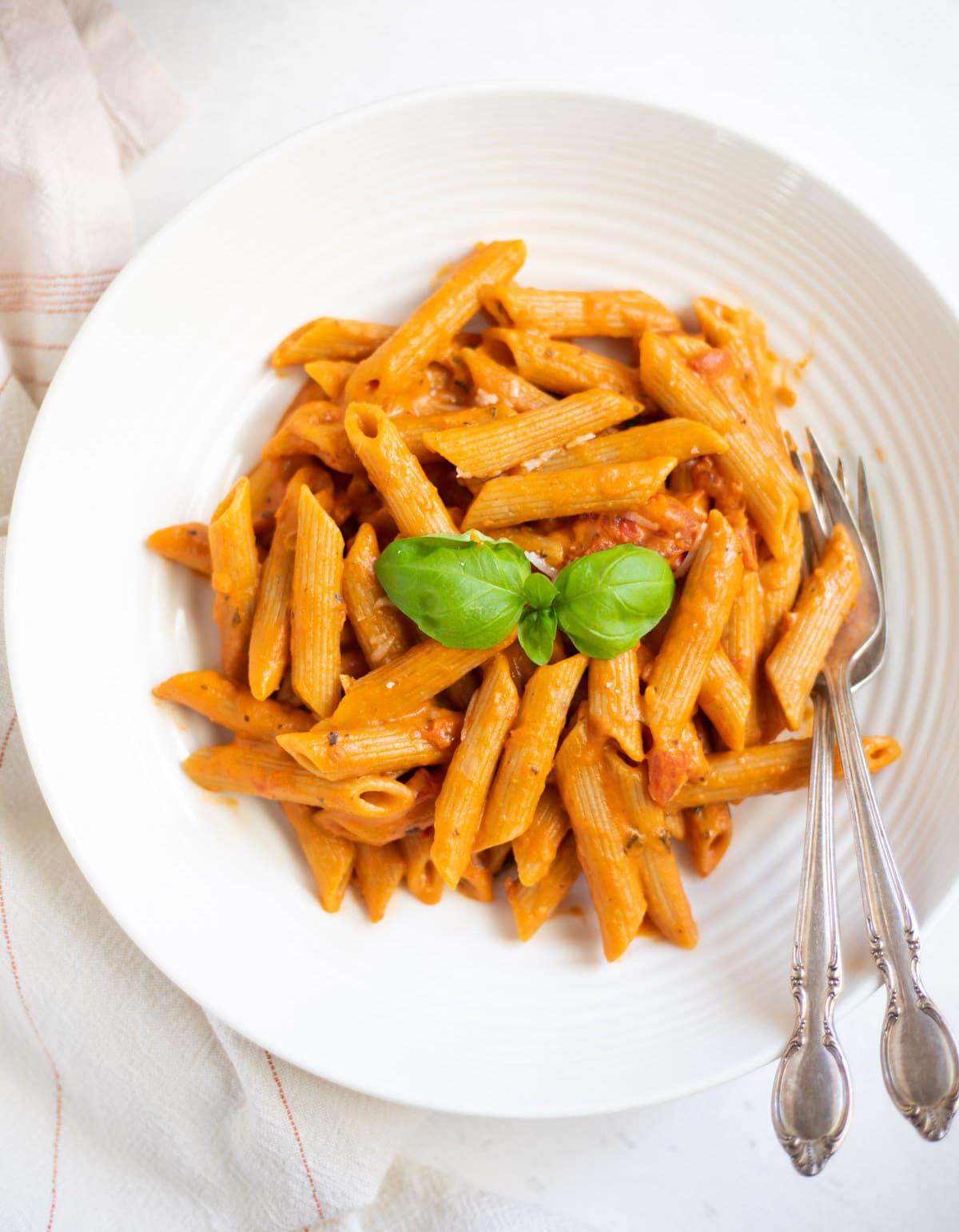 Penne Pasta in Tomato Cream Sauce in a white pasta bowl