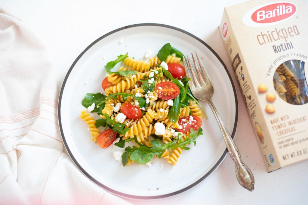 Rotini with arugula and cherry tomatoes topped with feta
