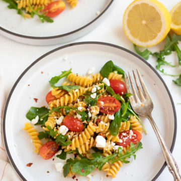 Rotini Chickpea Pasta with Arugula and cherry tomatoes topped with feta cheese