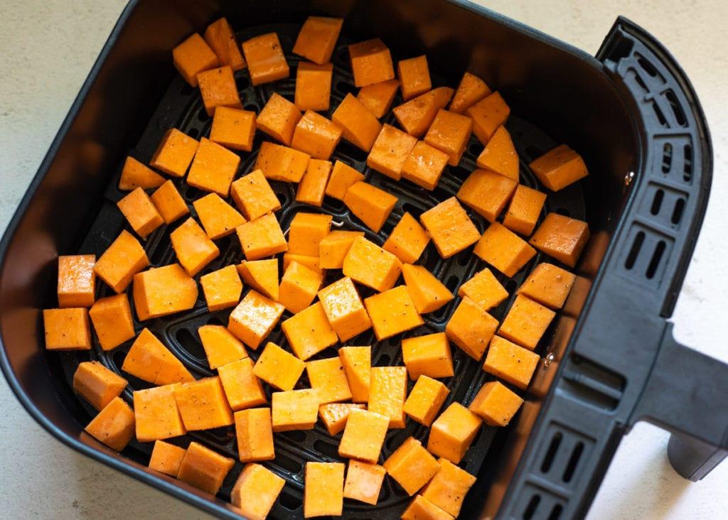Sweet potato cubes in an air fryer