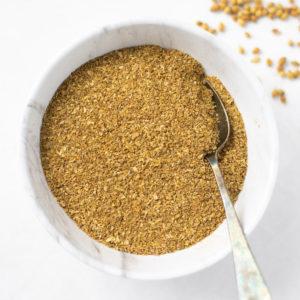Coriander / Dhaniya powder in a white bowl