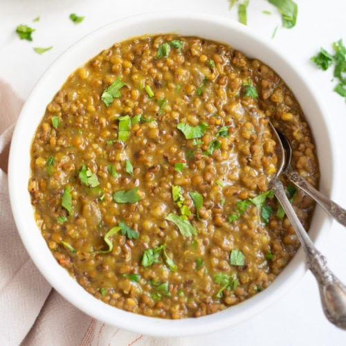 Moth beans dal in a bowl garnished with cilantro