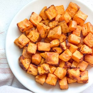 Roasted sweet potatoes in a white plate