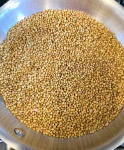 roast coriander seeds in a heavy bottom pan