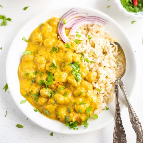 Coconut Chickpea Curry served over rice in a plate
