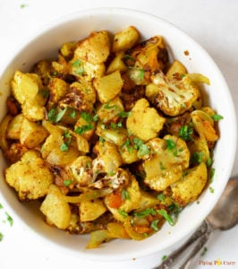 Indian Roasted Aloo Gobi (Potatoes and Cauliflower) in a bowl