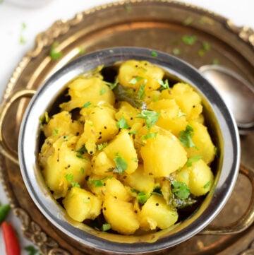 Potato masala in a bowl garnished with cilantro