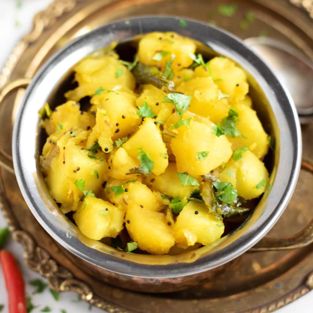 Potato Masala Bhaji in a small pretty bowl