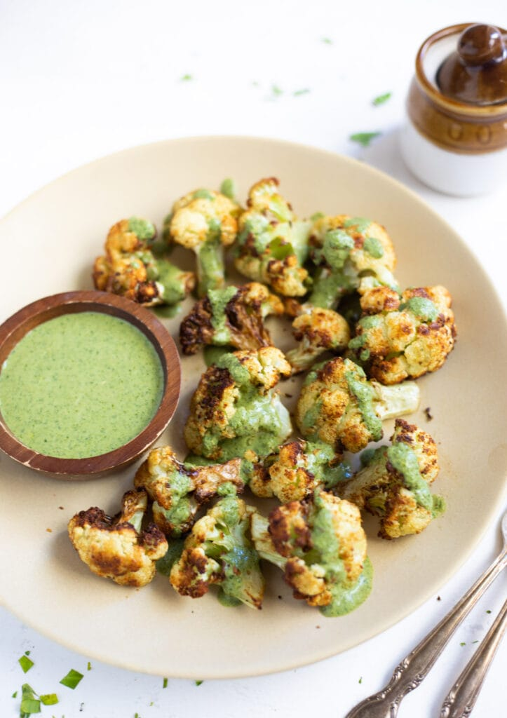 Roasted cauliflower topped with green cilantro sauce
