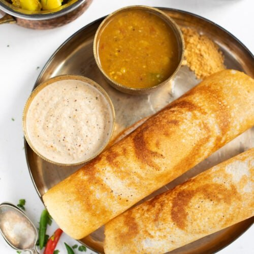 Crispy Dosa with chutney and sambar in a plate