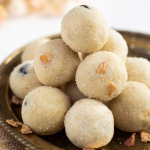 Rava Ladoo stacked in a pretty plate