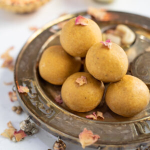 besan ladoo in a silver plate