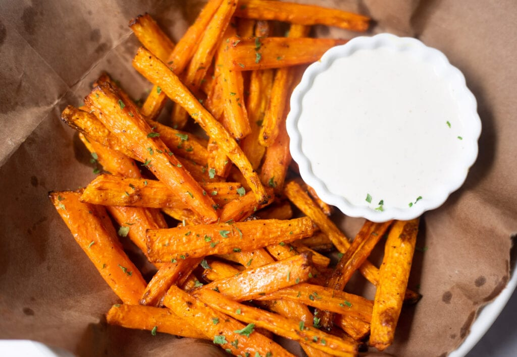 air fryer carrot fries with a bowl of dip