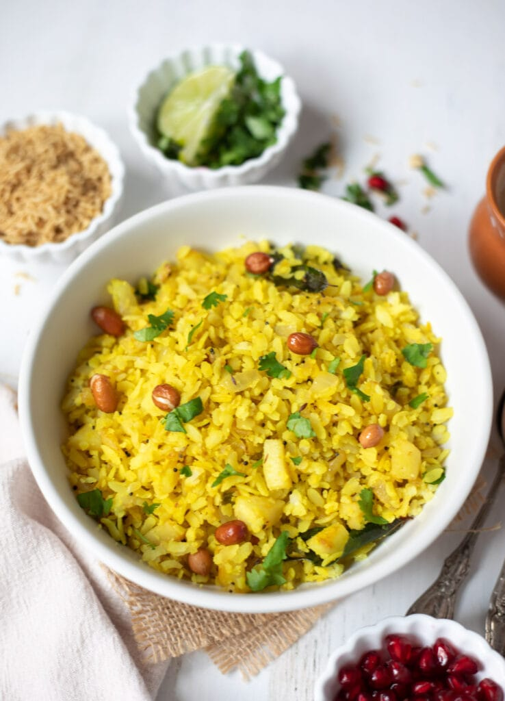 poha with garnishes and masala chai