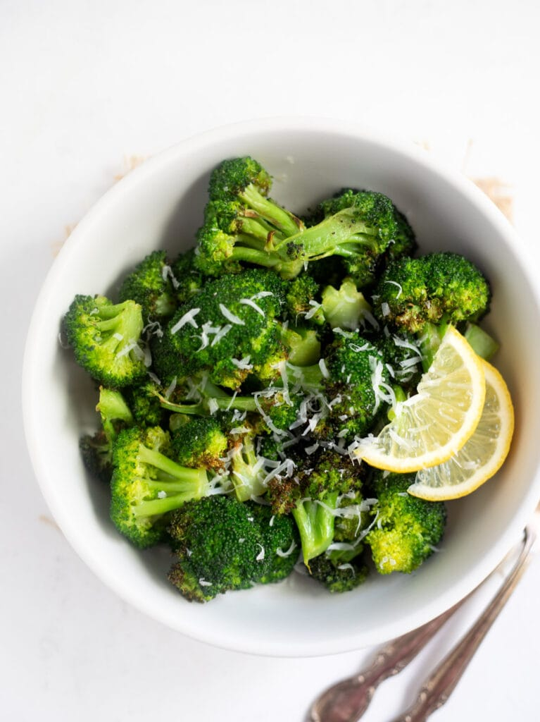 Roasted broccoli topped with lemon and parmesan