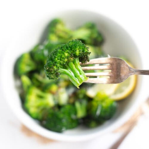Closeup of roasted broccoli in a fork