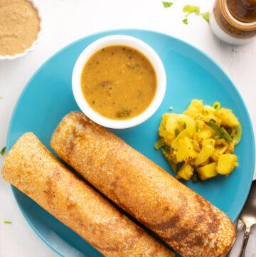 Two quinoa dosa with sambar, potato and chutney