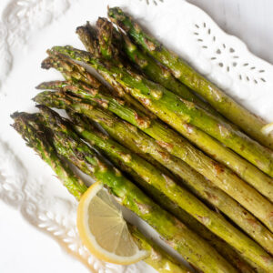 roasted asparagus a pretty white serving plate
