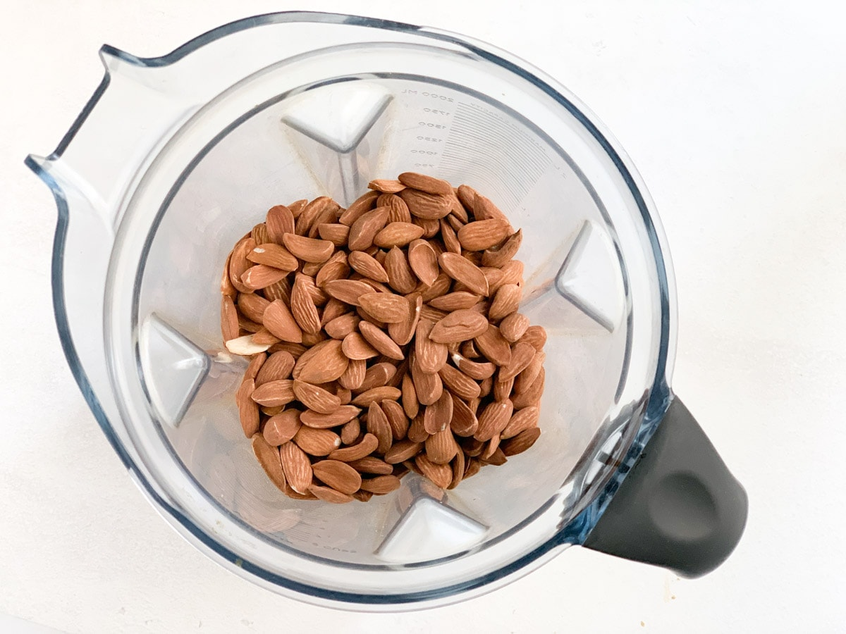 overhead shot of roasted almonds in a vitmix blender