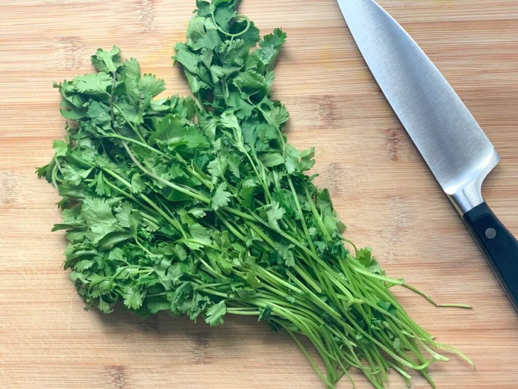 Fresh coriander leaves on a cutting board