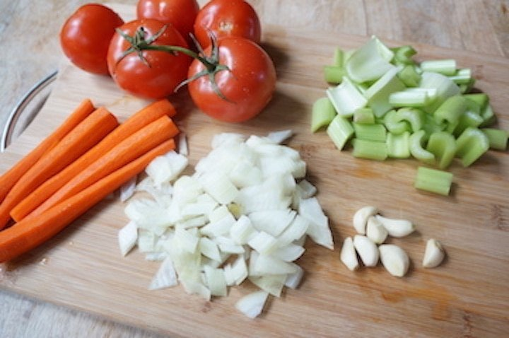 ingredients such as carrots, tomato, onions, garlic and lettuce