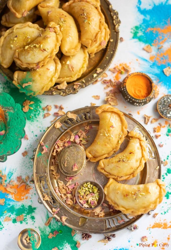 Mawa Gujiya (also called karanji, ghughra, kajjikayalu, karjikai) served for Holi