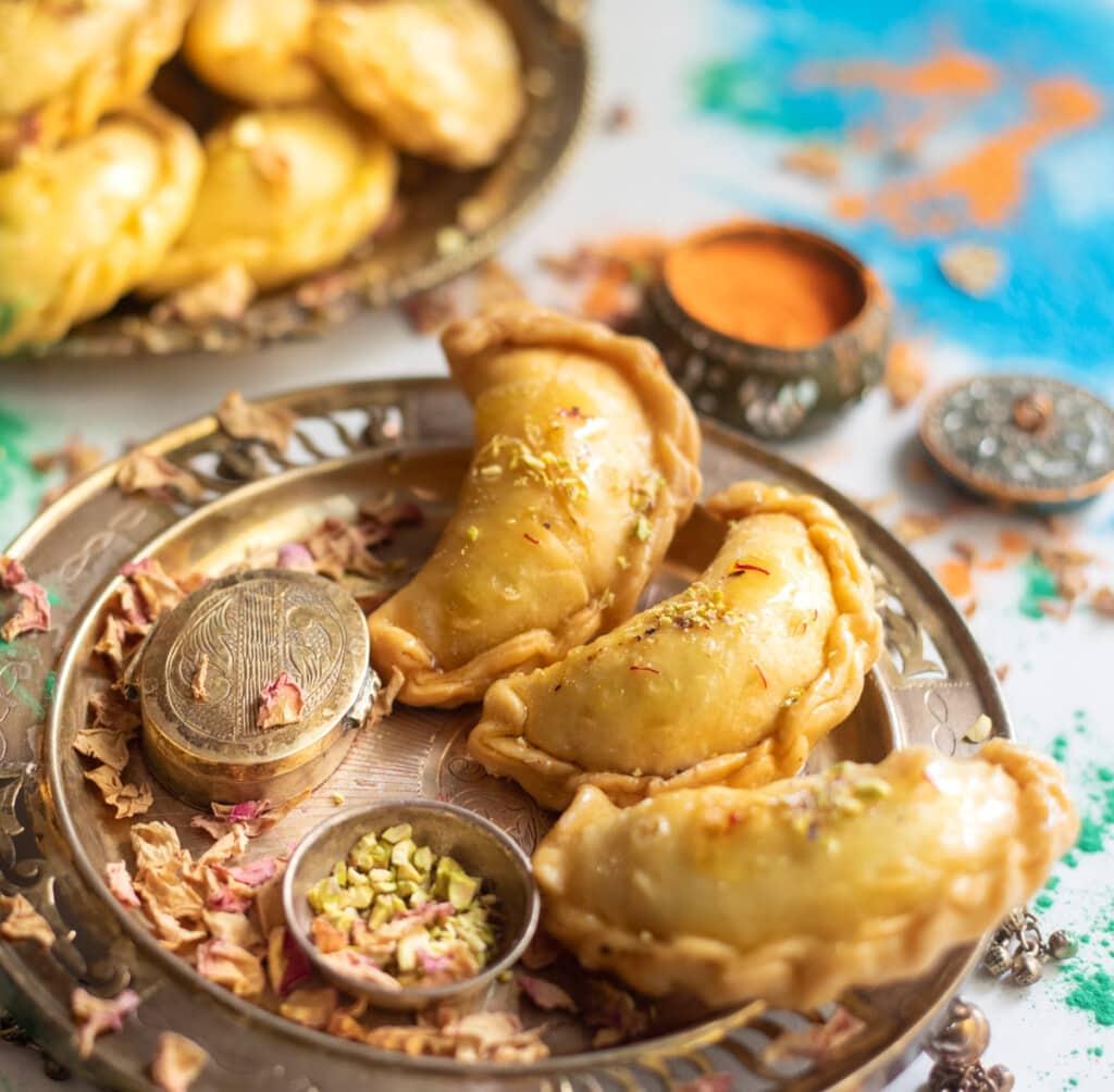Mawa gujiya for holi served In a beautiful silver plate