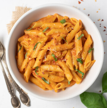 Creamy Penne Pasta topped with basil, parmesan and chili flakes