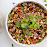 Indian Salad kachumber garnished with cilantro leaves