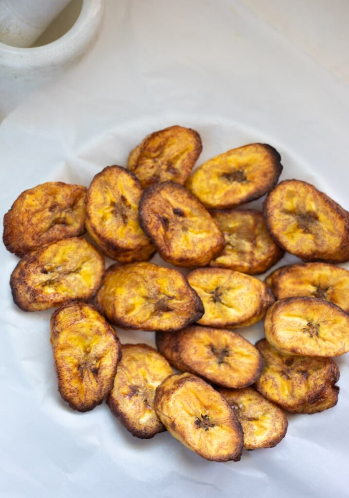 Healthy Fried Plantains served in a plate over parchment paper