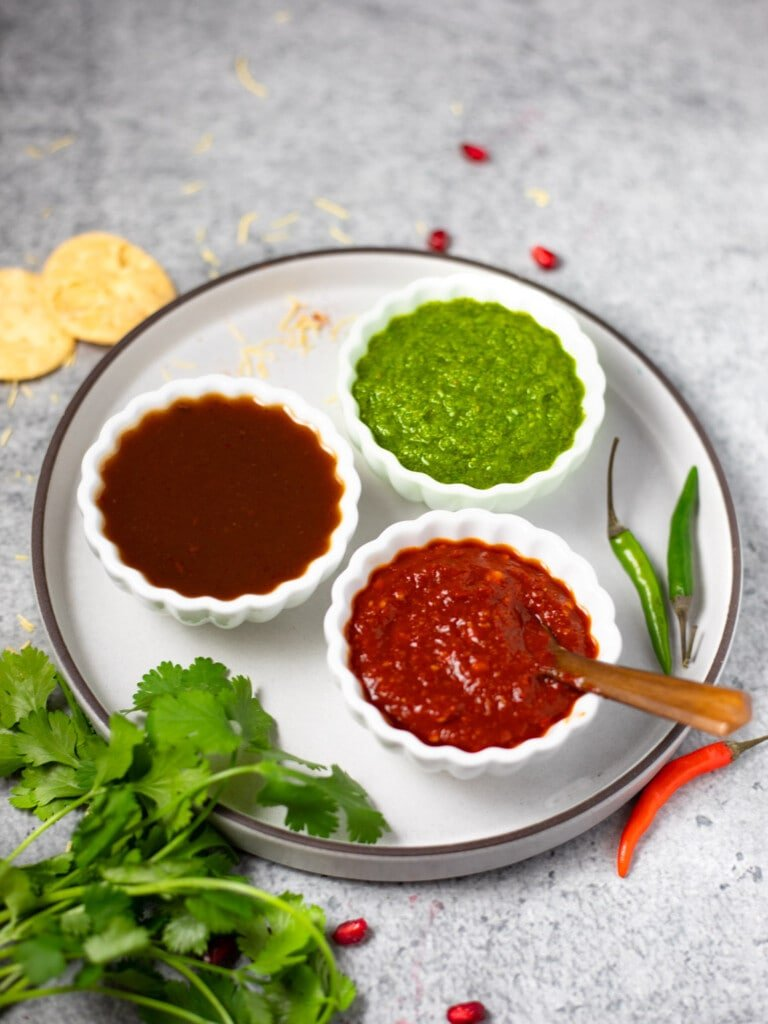 3 Indian chutney's in small white bowls