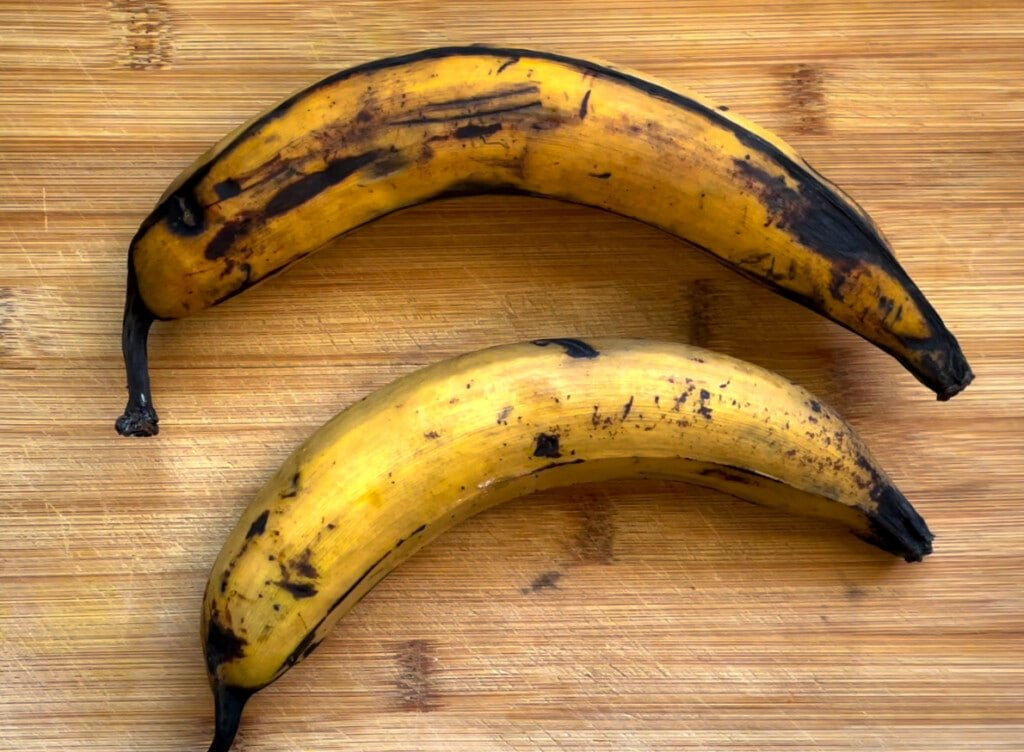 Two plantains on a cutting board