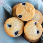 Moist Almond Flour Blueberry Muffins in a basket lined with cloth